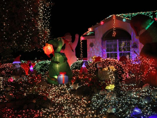 This house, located at 703 City View Drive, features both lights and inflatables.