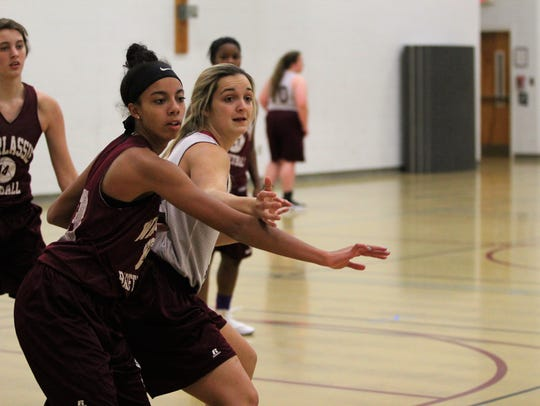 Chesney Gardner, right, fights for position in the
