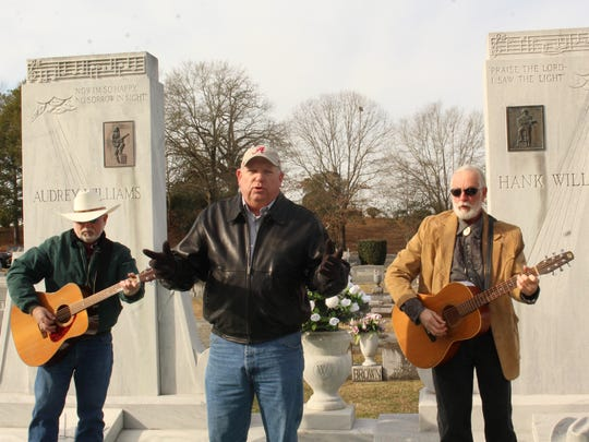 Jeff Petty is accompanied by Nathan Robinson and Randall Cauthen during Monday's ceremony honoring the memory of singing legend Hank Williams.