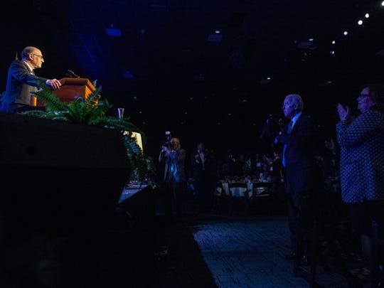 Former Vice President Joe Biden, right, applauds Delaware State Chamber of Commerce President Rich Heffron, left, as he speaks Monday night at the 181st Delaware State Chamber of Commerce Dinner at the Chase Center.