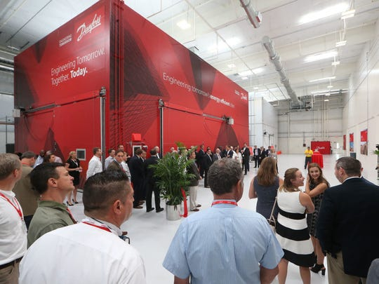 photos by Joe Rondone/Democrat People gather at Danfoss