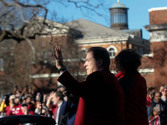 Alabama's coach Nick Saban waves to fans as he parades down the street during the NCAA college football national championship parade, Saturday, Jan. 20, 2018, in Tuscaloosa, Ala. Alabama won the national championship game against Georgia 26-23 in overtime. (AP Photo/Brynn Anderson)