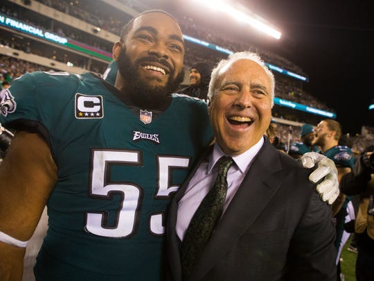 Philadelphia Eagles owner Jeffrey Lurie celebrates winning the NFC Championship with Brandon Graham 38-7 over the Minnesota Vikings Sunday at Lincoln Financial Field.
