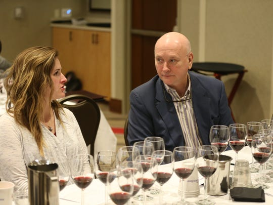 Jenna Rousseau, Central Wine, and Patrick Norton, the Phoenician, talk about their wine tasting during the Azcentral Arizona Wine Competition at the Hilton Garden Inn on December 11, 2018 in Phoenix, Ariz.