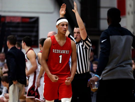 Minnehaha player Jalen Suggs reacts after dunking the