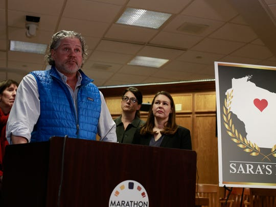 Scott Sann, husband of Sara Quirt Sann, talks about his wife, who was killed in a mass shooting in the Weston area in 2017, during the announcement of the proposed Sara's Law on Monday, Jan. 29, 2018, at the Marathon County Circuit Courthouse in Wausau, Wisconsin.
