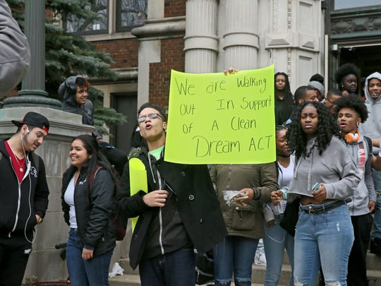 Students gather in front of Riverside University High School for a walkout in support of DACA students.
