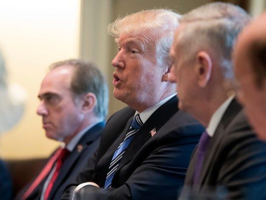 President Trump speaks beside Secretary of Veterans