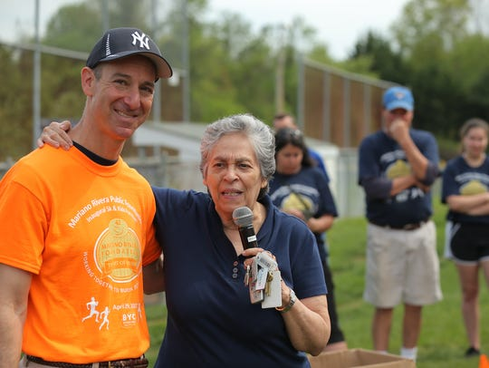 Mariano Rivera Foundation Executive Director Naomi Gandia with Wilmington attorney and foundation volunteer Russell Silberglied at last year's 5K in Pennsylvania.