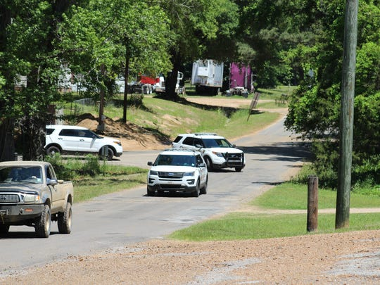 Rapides Parish Sheriff's units pull onto Parker Road from Hoyt Road in the Cotile Lake area Tuesday. There's a heavy police presence in the area during the search for Albert Micklus, a Boyce man wanted on home invasion, kidnapping and attempted murder charges.