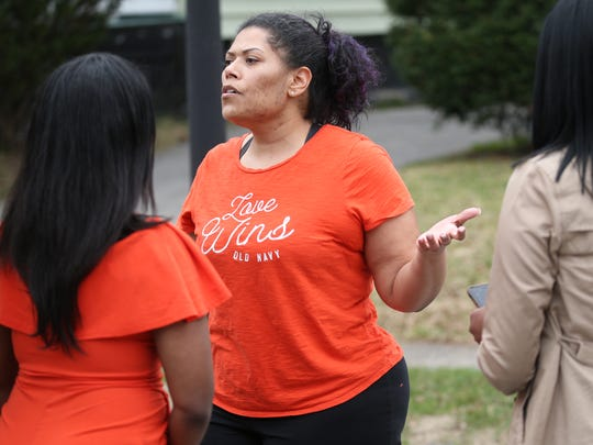 Judge Leticia Astacio talks outside her house Tuesday afternoon.