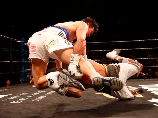 Abie Han gets taken down by Anthony Dirrell during