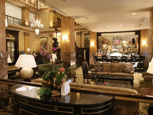 A view of the lobby of the hotel, where the seating area and bar are located.