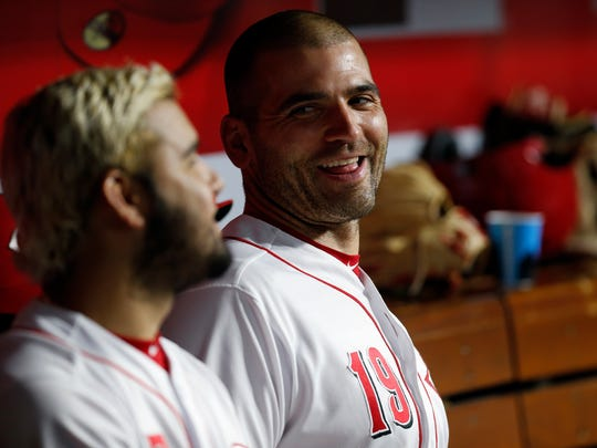 Cincinnati Reds first baseman Joey Votto (19) laughs