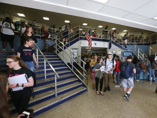 Students move to class at John Jay High School on May