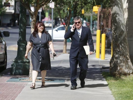 """William """"Billy"""" Abraham walks to a bankruptcy hearing"""