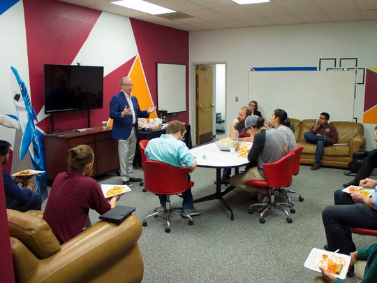 New Mexico State University alumnus Berry Mullennix talks with students at Arrowhead Center about the importance of entrepreneurship, thinking spatially and hard work.