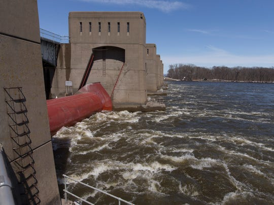 Turbulent water passes through a roller gate on the downstream side of Lock and Dam No. 7.
