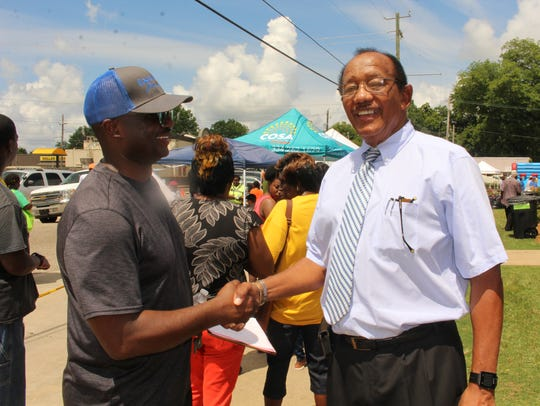 Former Selma Mayor George Evans greets a visitor to
