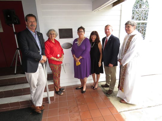 Showing the new plaque at the dedication ceremony, from left, are County Commissioner Doug Smith; Julie Preast, volunteer history researcher; church historian Joyce Fletcher Menar; Martin County Historic Preservation Board Member Joette Lorion Rice; Paul Neff, parish architect; and The Rev. W. Frisby Hendricks, III.