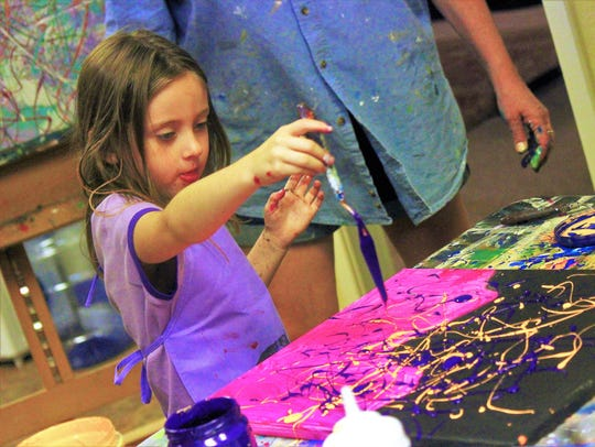 A little girl learns about the world of Jackson Pollock as she replicates his techniques of paint splatter.