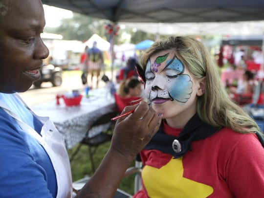 Lilliana Wimberley has her face painted by Rosetta
