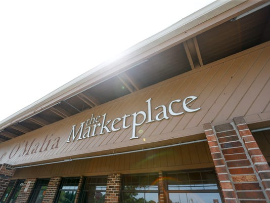 Carmel hopes to lure a grocer in O'Malia's old location