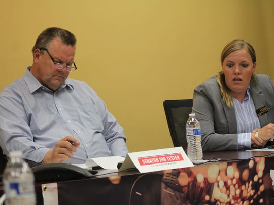 Tester listens to the concerns of Michelle Erickson-Jones, President of the Montana Grain Growers Association.