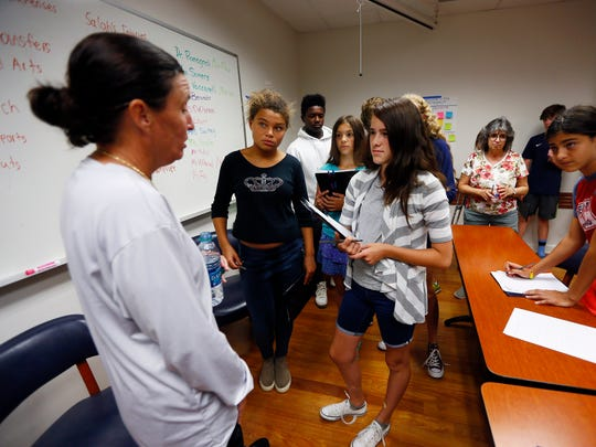 12-year-old Amanda Growney of Tinton Falls interviews Monmouth University women's soccer coach Krissy Turner who discussed women's sports and media with APP reporter Jerry Carino at Write on Sports, a free sports writing camp for middle-school students hosted by Monmouth each summer. August 2, 2018. West Long Branch, NJ
