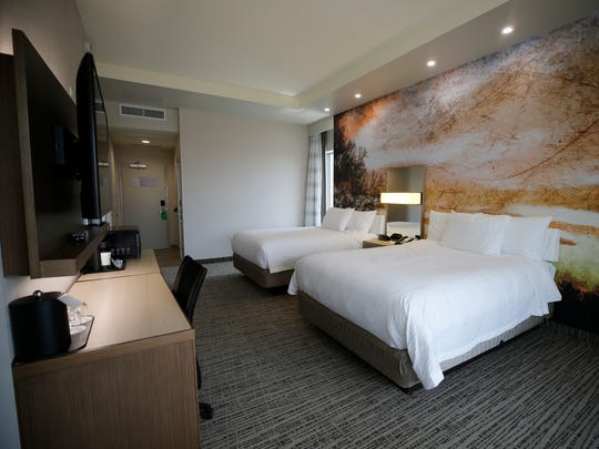 Most of the rooms are large in the new Courtyard by Marriott Hotel in Downtown El Paso. One wall in each room features a photographed scene from the hotel owner's backyard.