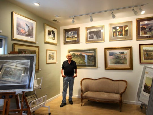 Michael in the Gallery where several of his pieces and his father's pieces are on display.