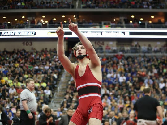 Carter Happel of Lisbon reacts after defeating Trey Brisker of Wilton during the 138 pound final in Class 1-A on Saturday, Feb. 21, 2015, at Wells Fargo Arena in Des Moines, Iowa.