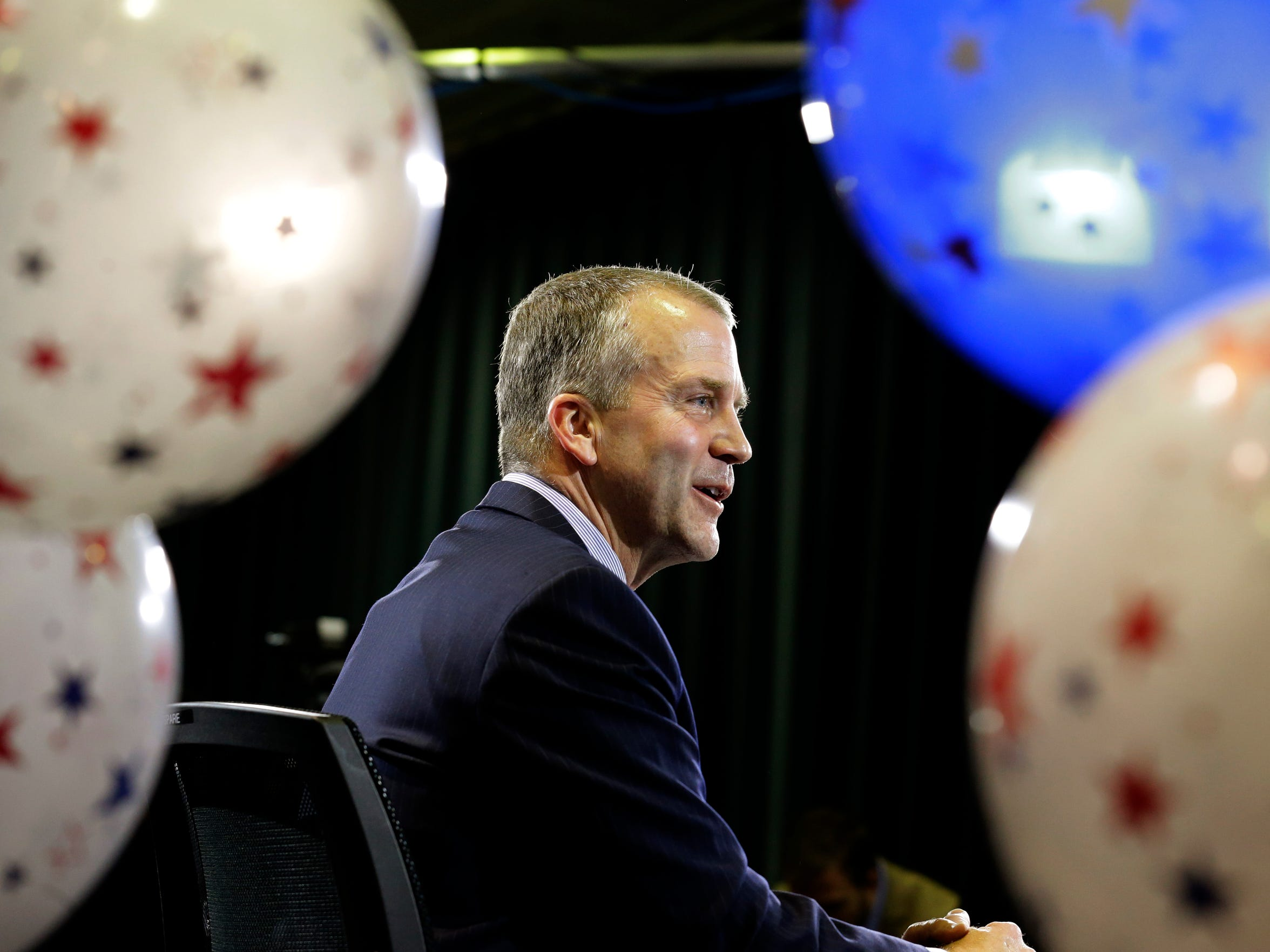 Republican U.S. Senate candidate Dan Sullivan takes part in a television interview on Nov. 4, 2014, in Anchorage Alaska.