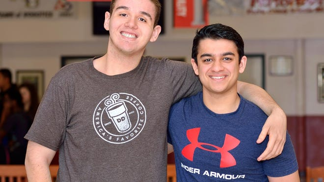Mike Tanious and Abdul Saeed in the commons of Mount Olive High School.