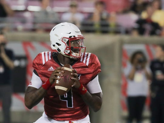 Redshirt sophomore Jawon Pass drops back to throw.