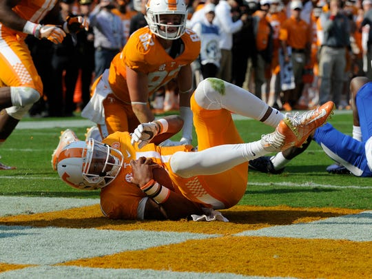 Tennessee quarterback Joshua Dobbs runs for a 1- yard