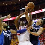 Houston Rockets' Terrence Jones (6) is fouled by Dallas Mavericks' Dirk Nowitzki (41) as Tyson Chandler (6) watches during the second half of Game 5 in the first round of the NBA basketball playoffs Tuesday, April 28, 2015, in Houston. (AP Photo/David J. Phillip)