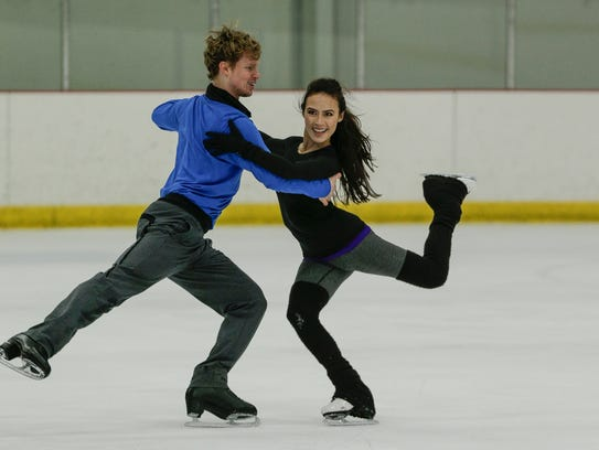 Evan Bates and Madison Chock practice at the Novi Ice Arena.