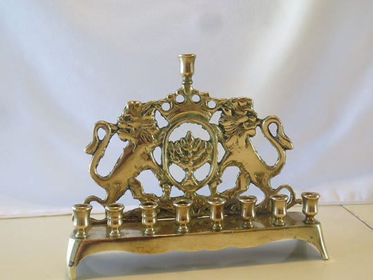 The Freireich family has two Hanukkah menorahs, including this one, which has been passed down for at least three generations.