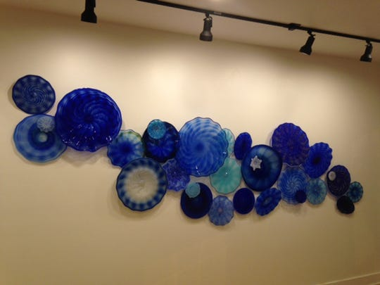 An art glass creation by Scott Krenitsky in various shades of blue, one of the pieces on display at the Chambersburg Council of the Arts.