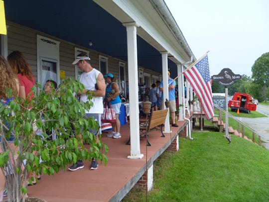 Displays from area organizations line Shank's Mare's