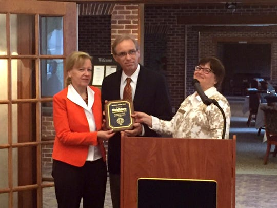 Lorraine Nagy, president, (right) presents the New Oxford Area Chamber of Commerce 2016 Business of the Year award to Sally and Jerry Smith, owners of Sleighter's Furniture and Sleep Shop.  Sleighters, a third generation, family owned business has been serving the community since 1947.