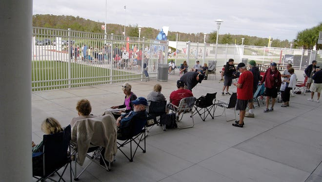Area baseball fans wait in line to purchase tickets for the Boston Red Sox 2016 Spring Training schedule at Jet Blue Park in Fort Myers on Saturday, Dec. 5, 2015. Over 200 people began gathering at the park as early as Friday morning.