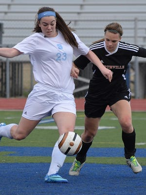 Livonia Stevenson soccer player Paige Ackman is pictured advancing the ball during a game last spring against Northville.