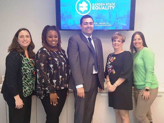Union County Freeholder Chairman Sergio Granados (center) attended the LGBTQ Pledge and Protect workshop at the county's Warinanco Sports Center in Roselle, organized by (from left) Union County Office of LGBTQ Services Coordinator Danni Newbury, Garden State Equality Health and Wellness Coordinator Bianca Mayes, Department of Human Services Division of Outreach and Advocacy Directory Maureen Segale Glenn, and Division on Aging and Disability Resource Connection Assistant Director Natalie Zarillo.