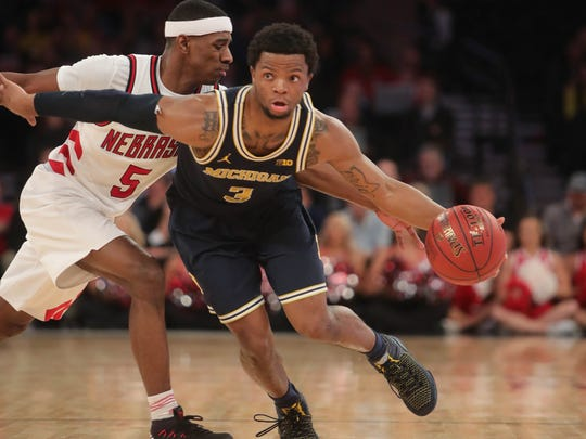 Michigan guard Zavier Simpson drives against Nebraska's Glynn Watson during the Wolverines' 77-58 win in the Big Ten tournament quarterfinals.