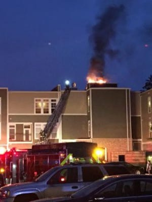 Carmel firefighters battle an apartment fire early Wednesday morning.
