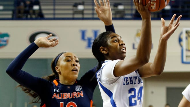 Kentucky's Taylor Murray (24) shoots while defended by Auburn's Brandy Montgomery (10) during an NCAA college basketball game Sunday, Jan. 17, 2016, in Lexington, Ky. Kentucky won 54-47. (AP Photo/James Crisp)
