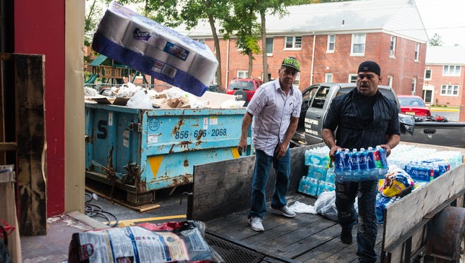 Efrain Rodgriguez and Humberto Diaz unload a truck of donations for those affected by recent hurricanes at the Vineland Salvation Army on Tuesday, September 12.