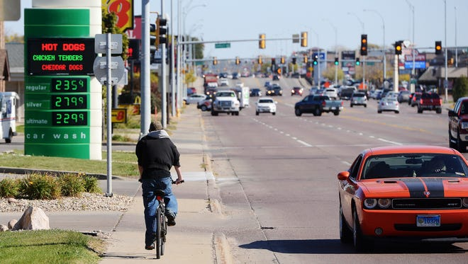 A bicyclist rides east on the sidewalk on  the north side of 41st Street near Shirley Ave Thursday. A bicyclist was struck in the same area last week and has since died.